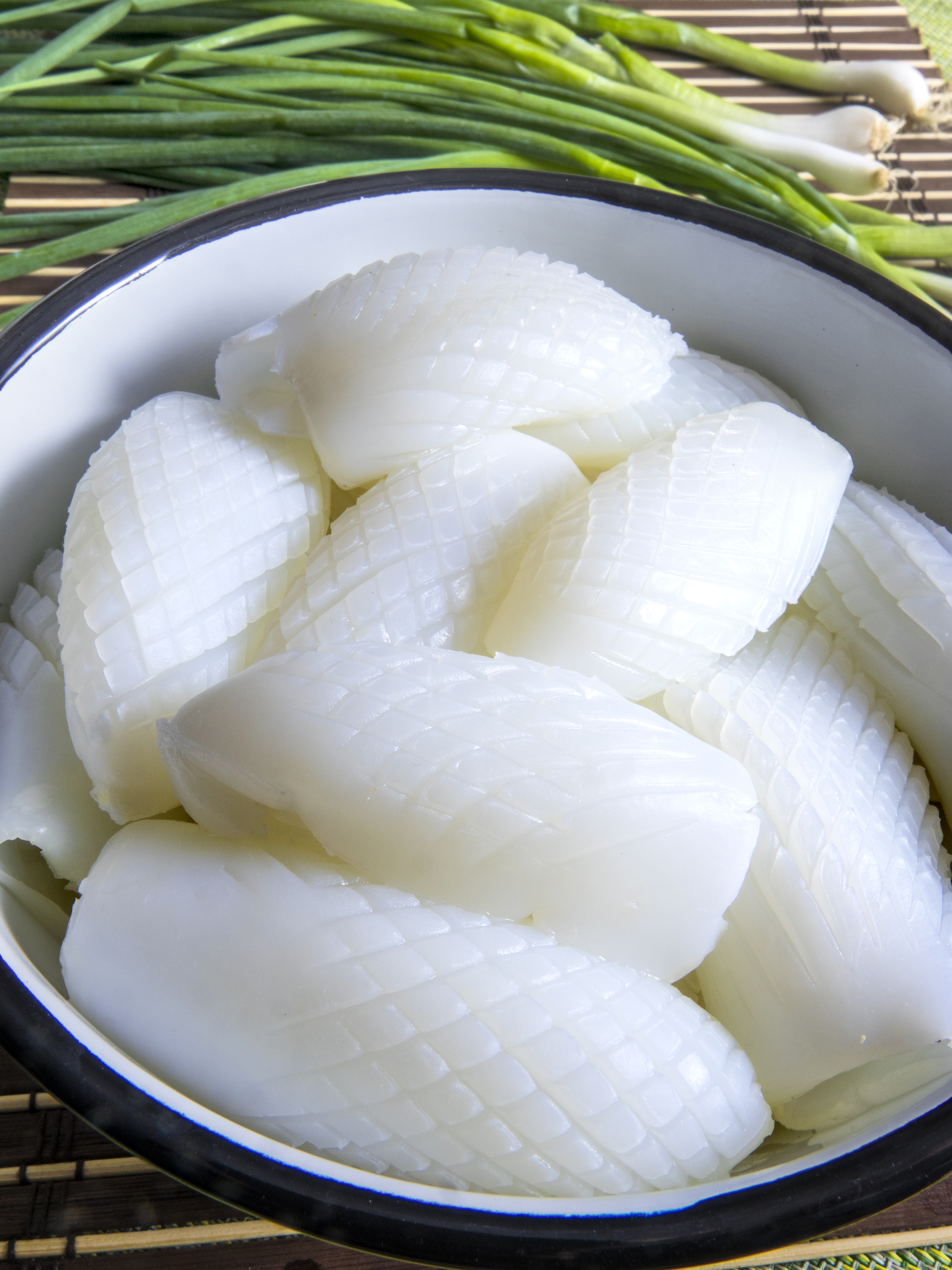 Vietnamese Cuisine: White Cuttlefish Raw On A Bamboo Background